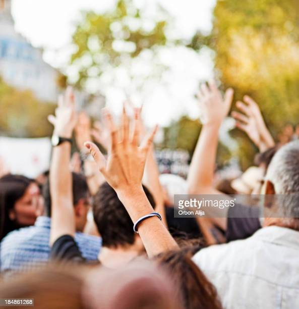raising hands - demonstration stock pictures, royalty-free photos & images