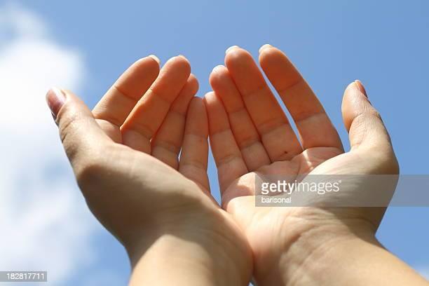 Raising hands towards sky