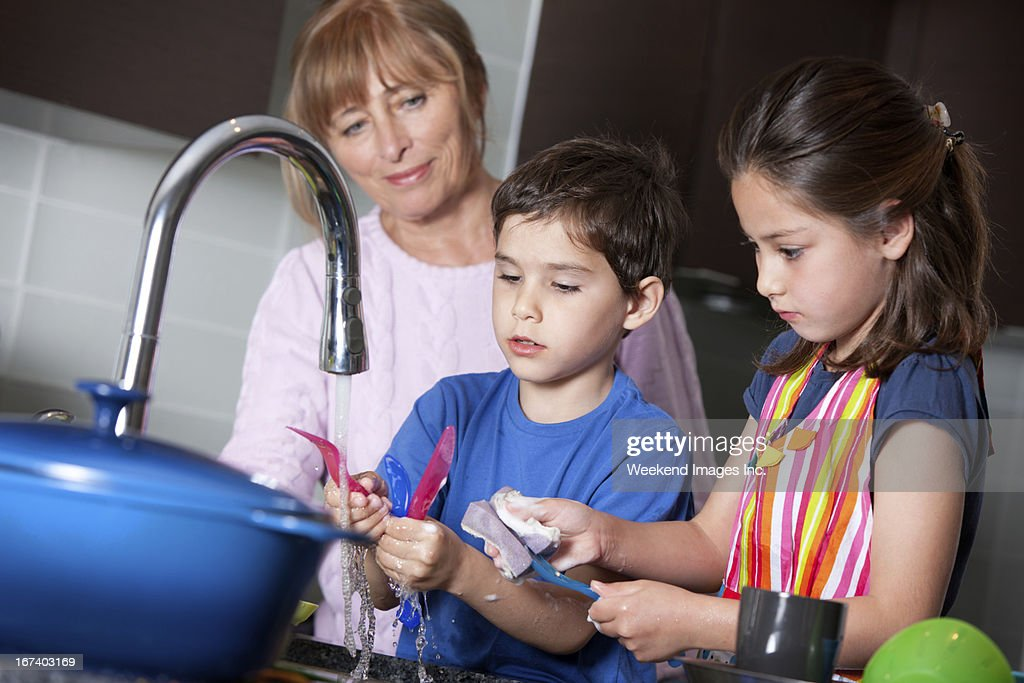 Raising little helpers : Stock Photo