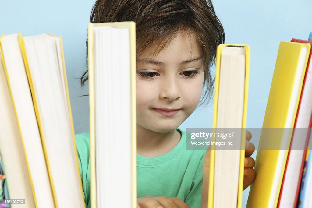 Raising Little Reader : Stock Photo