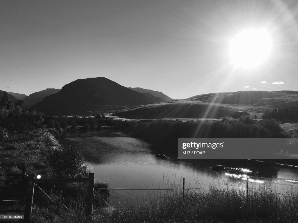 Raising sun over the mountain : Stock Photo