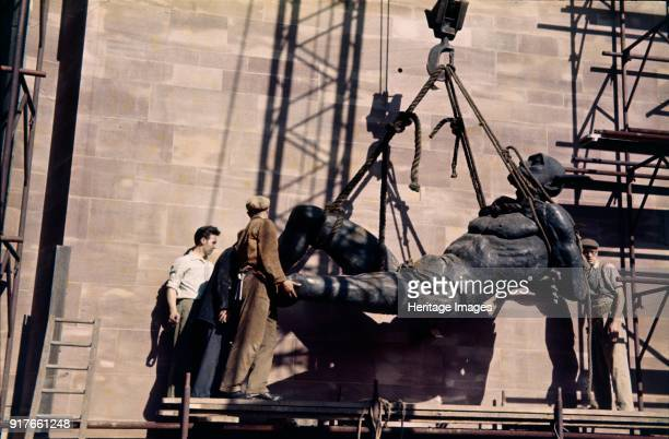 Raising the devil 19611962 Jacob Epstein's sculpture of the devil being hoisted into position at St Michael's Cathedral Coventry Artist John Laing