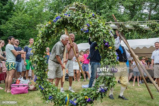 Raising the maypole during the midsummer feast in Skanör Midsummer is a time of feast in Sweden celebrating the days when the sun stays up over the...