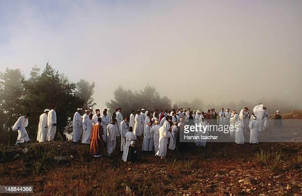 raising the torah scrolls ceremony during the samaritan pilgrimage at shavuot, mount gerizim. - pilgrimage stock pictures, royalty-free photos & images