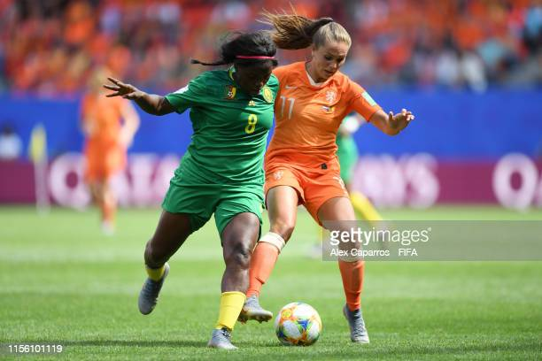 Raissa Feudjio of Cameroon battles for possession with Lieke Martens of the Netherlands during the 2019 FIFA Women's World Cup France group E match...