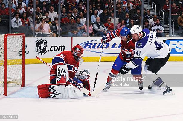 Raitis Ivanans of the Los Angeles Kings gets a shot off and Jaroslav Halak of the Montreal Canadiens makes the save on March 8 2008 at Staples Center...