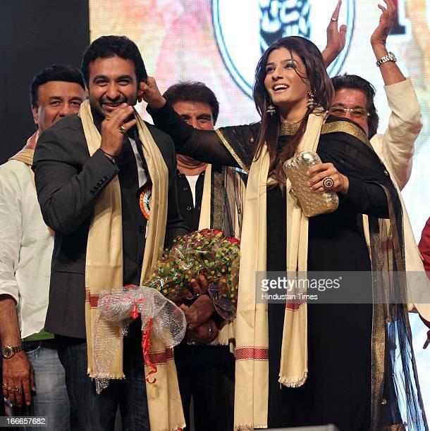 Raj Kundra with Raveena Tandon at Baisakhi Celebration cohosted by G S Bawa and Punjab Association Of India on April 13 2013 in Mumbai India