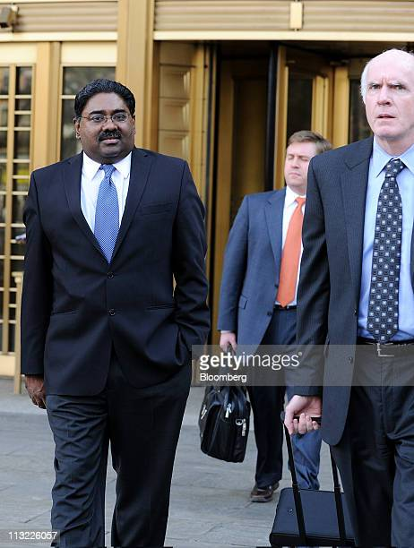 Raj Rajaratnam the Galleon Group LLC cofounder accused of insider trading left exits federal court with his attorney Terence Lynam right in New York...
