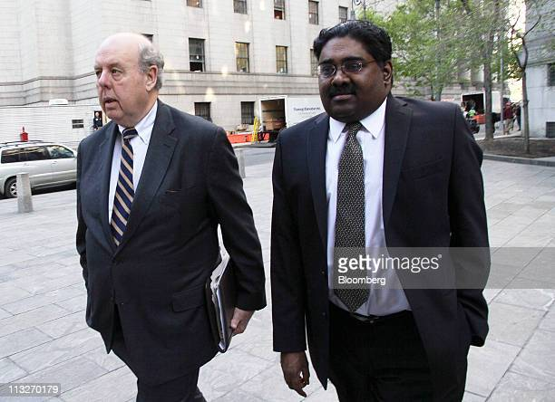 Raj Rajaratnam the Galleon Group LLC cofounder accused of insider trading right arrives with his attorney John Dowd at federal court in New York US...