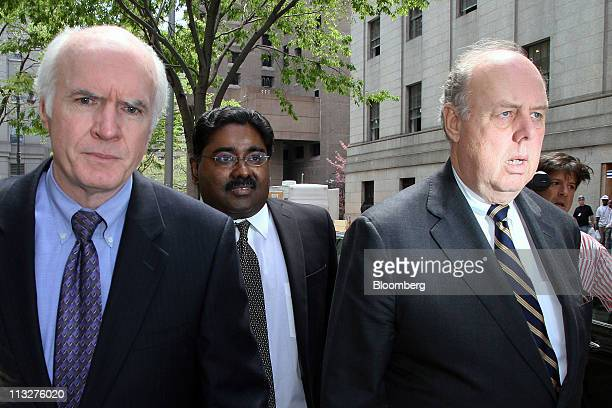Raj Rajaratnam the Galleon Group LLC cofounder accused of insider trading center exits federal court with his attornies Terence Lynam left and John...