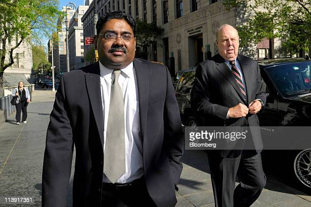 Raj Rajaratnam the Galleon Group LLC cofounder accused of insider trading left arrives with his attorney John Dowd at federal court in New York US on...