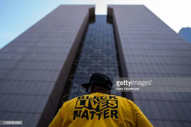 Raj Sethuraju, wearing a Black Lives Matter t-shirt, stands with the Hennepin County Government Center looming over him during the inaugural...