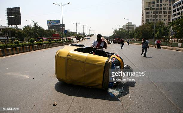 Raj Thackeray Arrest MNS Violence MNS activists overturned an Autorickshaw on the Western Express highway at Bandra as police produce its chief Raj...