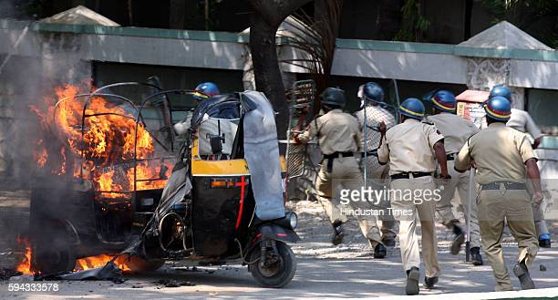Raj Thackeray Arrest MNS Violence MNS activists put a Autorickshaw on Fire Police lathi charged MNS activists gathered on the Western Express highway...