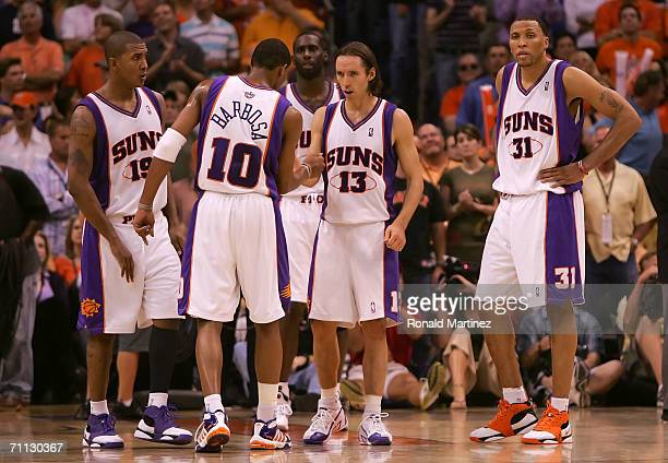 Raja Bell Leandro Barbosa Tim Thomas Steve Nash and Shawn Marion of the Phoenix Suns talk together during a timeout in the fourth quarter against the...