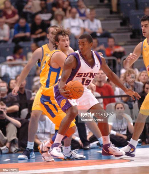 Raja Bell of Phoenix tries to get past Macabbi's Simas Jasaitis during the NBA Europe Live Tour presented by EA Sports on October 11 2006 at the...