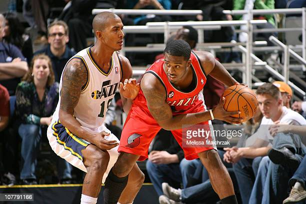 Raja Bell of the Utah Jazz guards Wesley Matthews of the Portland Trail Blazers at EnergySolutions Arena on December 27 2010 in Salt Lake City Utah...