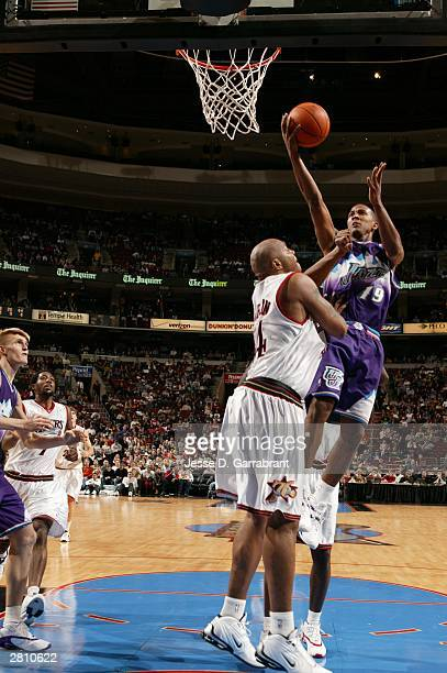Raja Bell of the Utah Jazz shoots against Derrick Coleman of the Philadelphia 76ers at the Wachovia Center on December 14, 2003 in Philadelphia,...