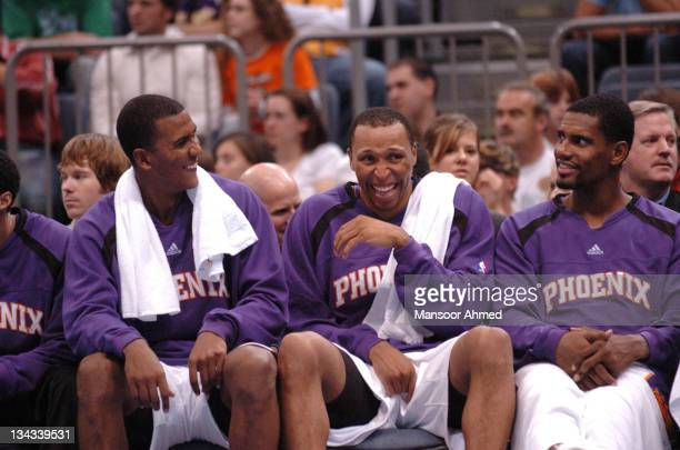 Raja Bell Shawn Marion and Kurt Thomas of the Phoenix Suns share a joke from the bench during the NBA Europe Live Tour presented by EA Sports on...