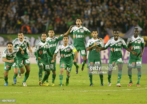 Raja Casablanca football team players celebrate after scoring a goal during their Morocco Cup match against Difaa d'El Jadida on November 18 2013 in...