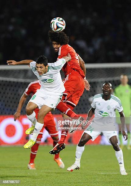 Raja Casablanca's Chemseddine Chtibi and Bayern Munich's Dante rise for the ball during the final match between Germany's Bayern Munich and Morocco's...