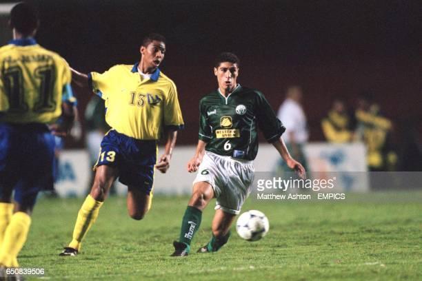 Raja Casablanca's Youssef Safri plays the ball forward as Al Nassr's Ahmed Bahja
