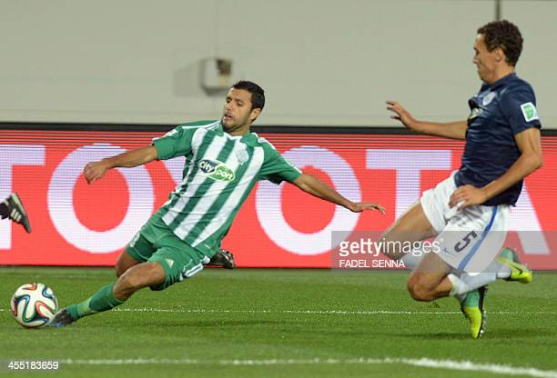 Raja Casablanca's Zakaria El Hachimi vies for the ball against Auckland City's Angel Berlanga as they open the FIFA Club World Cup with a preliminary...