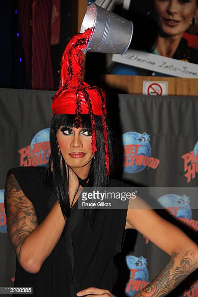 Raja The Winner of 'RuPaul's Drag Race' Season 3 donates a hat as she visits Planet Hollywood Times Square on April 26 2011 in New York City