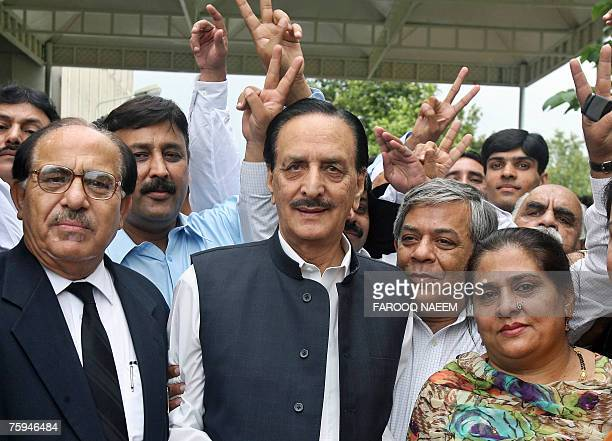 Raja Zafar ulHaq a senior party leader of former Pakistani Prime Minister Nawaz Sharif's party and other leaders pose while leaving The Supreme Court...
