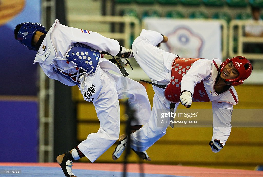 Raja Zulfadli Bin Raja Mah of Singapore in action against Peerathep Sila-on of Thailand during day two of the 20th Asian Taekwondo Championships at Phu Tho Stadium on May 10, 2012 in Ho Chi Minh City, Vietnam.