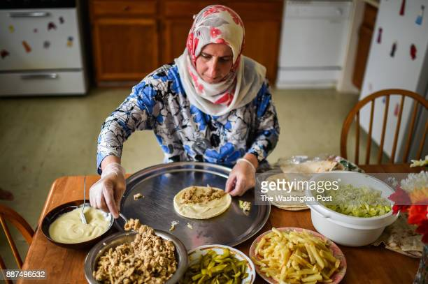 Rajaa Abbas of Dundalk MD makes chicken shawarma sandwiches at home on Tuesday August 8 in Dundalk MD The sandwich contains seasoned chicken French...