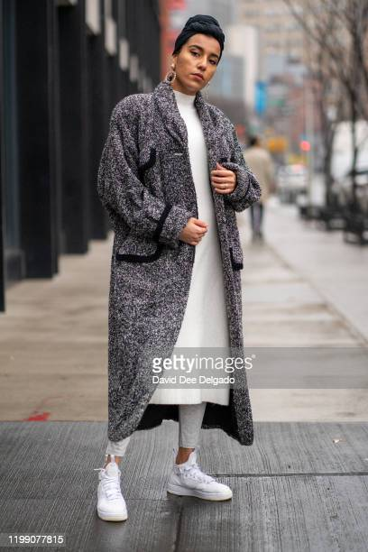 RaJaa Blake wears a jacket by Urban Jungle, dress by Zara and sneakers by Nike to NYFW on February 6, 2020 in New York City.