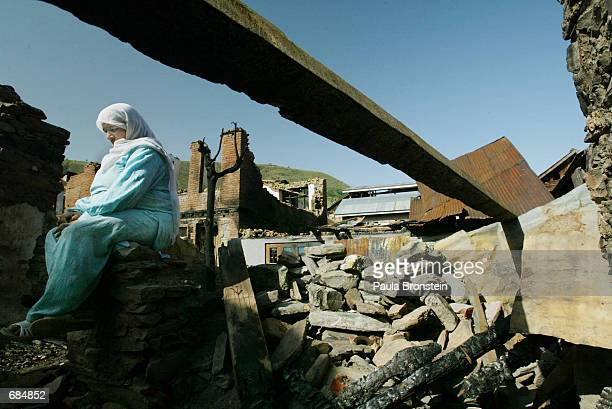Rajabajam sits among the ruins of her home June 10 2002 in Baramulla Kashmir India The house was destroyed by the Indian Army during a raid looking...
