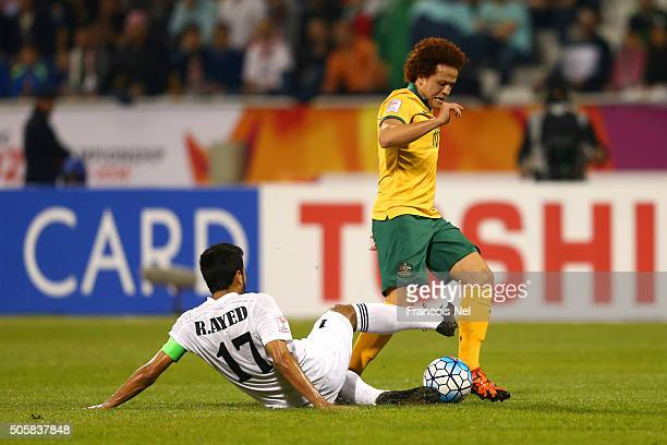Rajaei Ayed Fadel Hasan of Jordan slides in on Mustafa Amini of Australia during the AFC U23 Championship Group D match between Jordan and Australia...