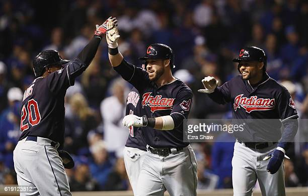 Rajai Davis and Coco Crisp of the Cleveland Indians congratulate Jason Kipnis after Kipnis hit a home run in the seventh inning against the Chicago...