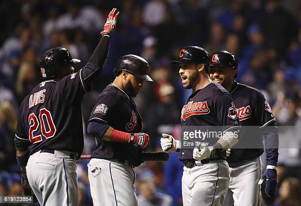 Rajai Davis Carlos Santana and Coco Crisp of the Cleveland Indians congratulate Jason Kipnis after Kipnis hit a home run in the seventh inning...