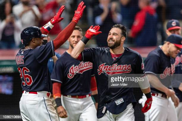 Rajai Davis celebrates with Jason Kipnis of the Cleveland Indians after Kipnis hit a walkoff grand slam to defeat the Chicago White Sox at...