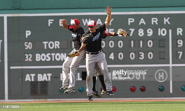 Rajai Davis Eric Thames and Travis Snider of the Toronto Blue Jays celebrate a 97 win over the Boston Red Sox at Fenway Park on July 4 2011 in Boston...