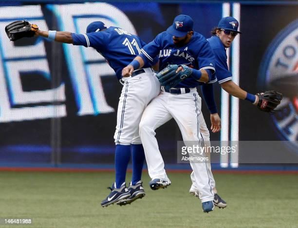 Rajai Davis Jose Bautista and Colby Rasmus of the Toronto Blue Jays celebrate 62 win against the Philadelphia Phillies during interleague MLB action...