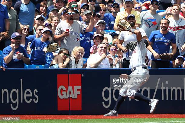 TORONTO ON JULY 2 Rajai Davis makes a catch in foul territory as the Toronto Blue Jays play the Cleveland Indians at the Rogers Centre in Toronto...