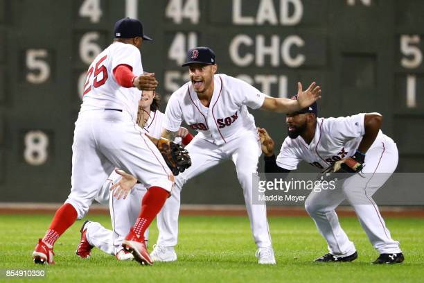 Rajai Davis of the Boston Red Sox Andrew Benintendi Joe Kelly and Jackie Bradley Jr #19 celebrate after defeating the Toronto Blue Jays 107 at Fenway...