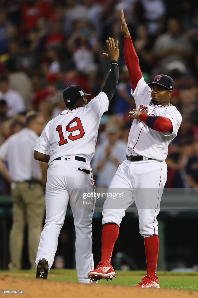 Rajai Davis #25 of the Boston Red Sox (R) celebrates with Jackie Bradley Jr. #19 after defeating the Houston Astros 10-3 in game three of the American League Division Series at Fenway Park on October 8, 2017 in Boston, Massachusetts.