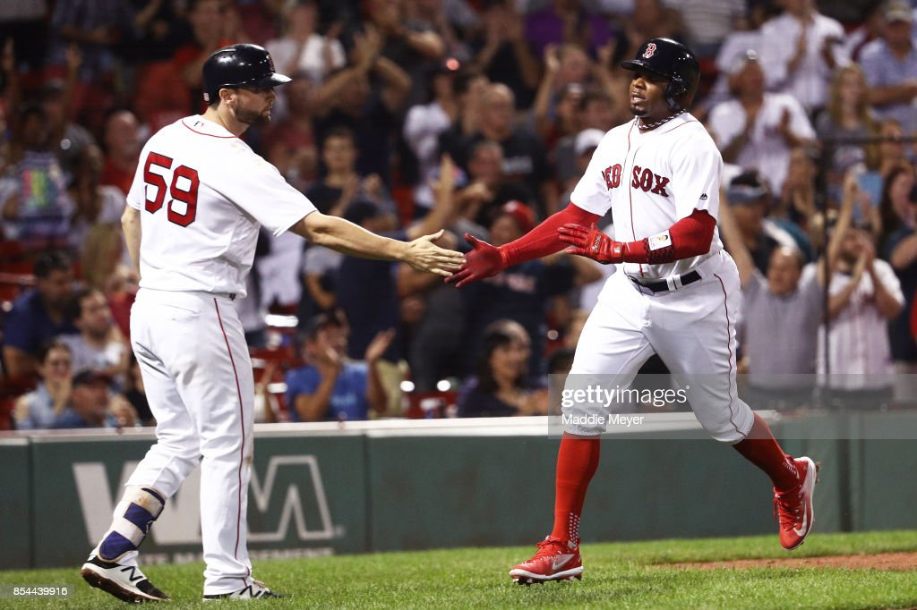 Rajai Davis #25 of the Boston Red Sox celebrates with Sam Travis #59 after scoring a run against the Toronto Blue Jays during the eighth inning at Fenway Park on September 26, 2017 in Boston, Massachusetts.