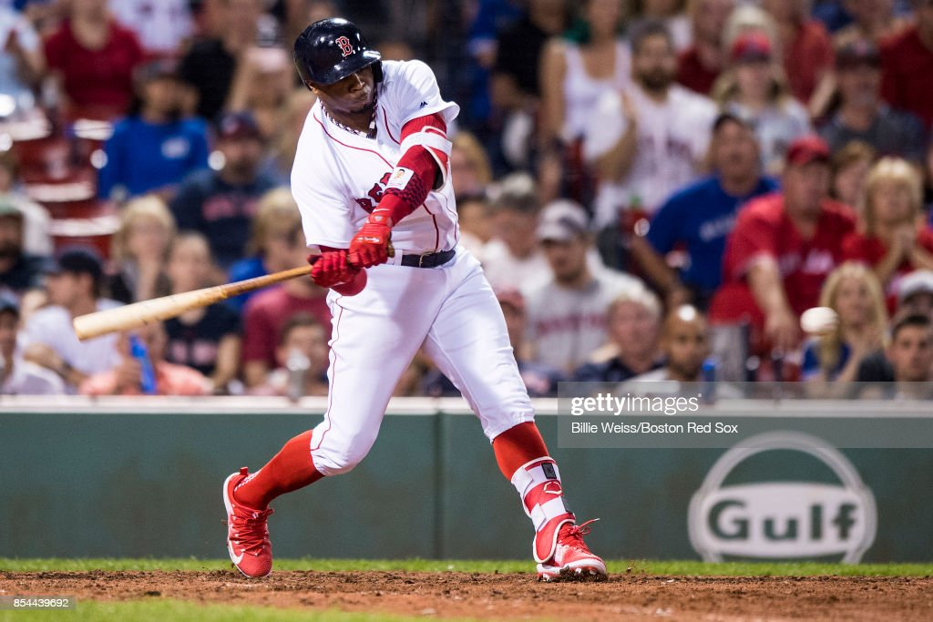 Rajai Davis #25 of the Boston Red Sox hits an RBI double during the eighth inning of a game against the Toronto Blue Jays on September 26, 2017 at Fenway Park in Boston, Massachusetts.
