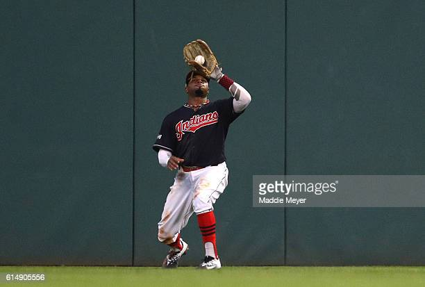 Rajai Davis of the Cleveland Indians catches the final out hit by Troy Tulowitzki of the Toronto Blue Jays to end the ninth inning during game two of...
