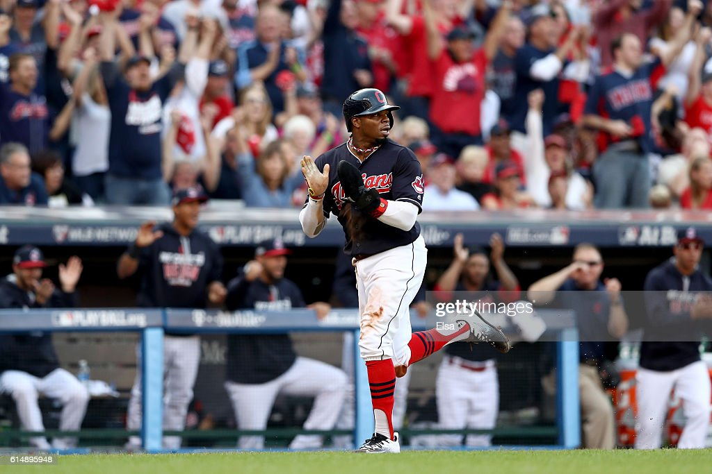 Rajai Davis #20 of the Cleveland Indians celebrates after scoring a run off of a single hit by Francisco Lindor #12 in the third inning against J.A. Happ #33 of the Toronto Blue Jays during game two of the American League Championship Series at Progressive Field on October 15, 2016 in Cleveland, Ohio.
