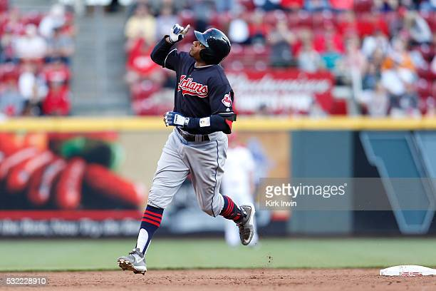 Rajai Davis of the Cleveland Indians celebrates his solo home run while rounding second base during the top of the third inning of the game against...