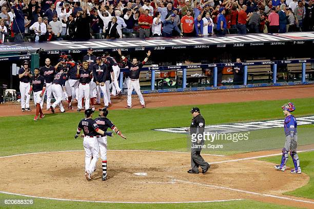 Rajai Davis of the Cleveland Indians celebrates with Brandon Guyer after hitting a tworun home run during the eighth inning to tie the game 66...
