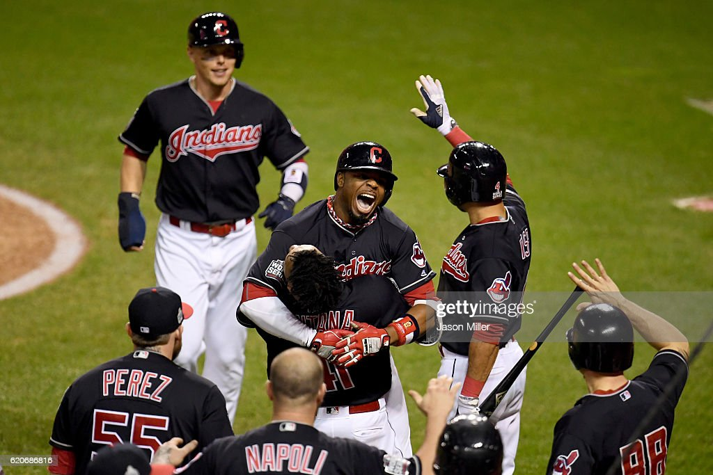 Rajai Davis #20 of the Cleveland Indians celebrates with teammates after hitting a two-run home run during the eighth inning to tie the game 6-6 against the Chicago Cubs in Game Seven of the 2016 World Series at Progressive Field on November 2, 2016 in Cleveland, Ohio.