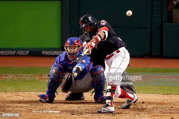 Rajai Davis of the Cleveland Indians hits a tworun home run during the eighth inning to tie the game 66 against the Chicago Cubs in Game Seven of the...